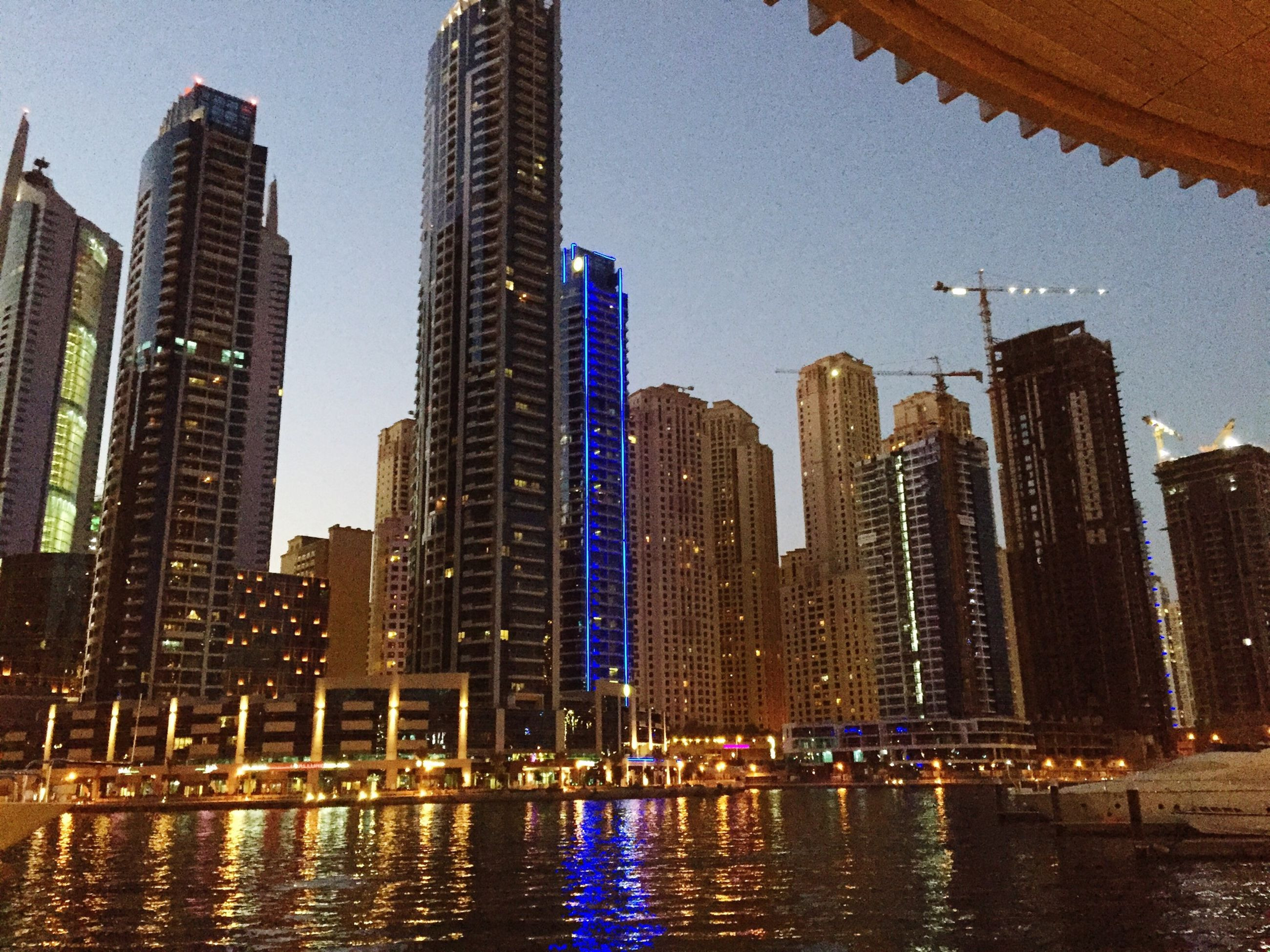 building exterior, architecture, water, built structure, city, skyscraper, waterfront, reflection, modern, office building, tall - high, urban skyline, cityscape, financial district, tower, clear sky, illuminated, building, city life, river