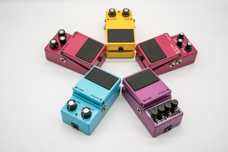 Group of vintage guitar pedal isolated on white background Classic Delay Effects Flanger Modulation Retro Sound Adjust Boxes Chorus Colorful Design Distortion Guitar Knobs Overdrive Pedal Stompbox Style Tone Vintage Vintage Photo Voice Volume