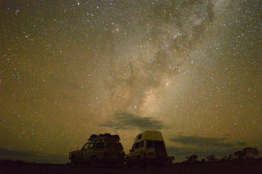 Unspoiled night sky offers terrific photo opportunities! This is on of our favourite daily pictures, taken in the area around Alice Springs, Australia. Adult Astronomy Australia Backpacking Beauty In Nature Car Constellation Dark Galaxy Goodnight Milky Way Nature Night No People Outback Outdoors Relaxing Scenics Science Sky Space Space And Astronomy Star - Space Star Field Traveling