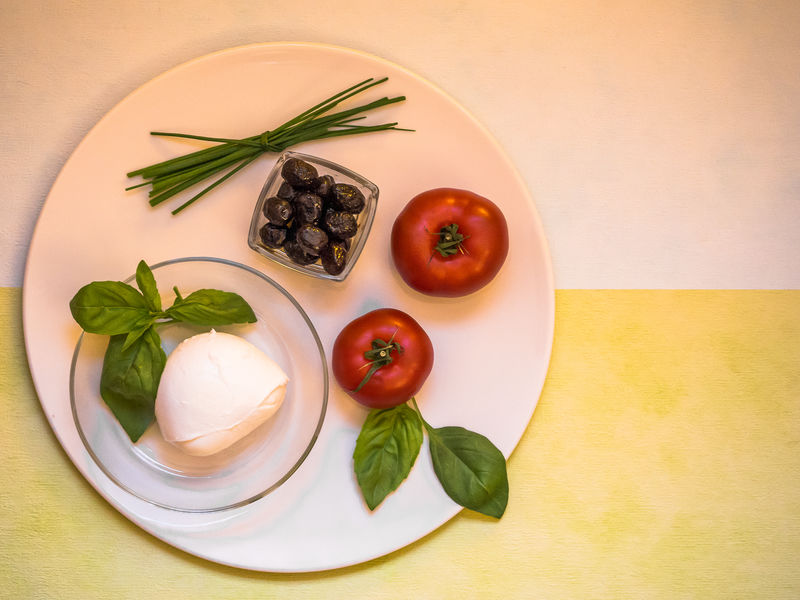 healthy eating Cooking EyeEmNewHere Food And Drink Basil Leafs Composition Of Food, Edithnerophotography Food Food And Drink Foodphotography Freshness Healthy Eating Healthy Food Healthy Lifestyle Indoors  Kitchen kitchen utensils Light Food No People Table Vegetable Vitamines Vitamines In Nature White Plate White Plate With Food White Plate With Tomatoes