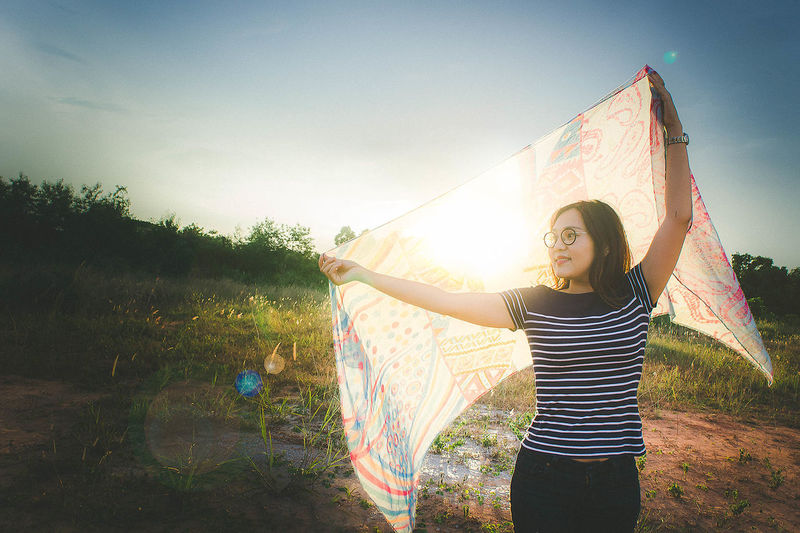 Play light Adult Beauty In Nature Casual Clothing Cheerful Day Fun Girls Grass Happiness Leisure Activity Lifestyles Light And Shadow Nature One Person Outdoors People Portrait Real People Sky Smiling Standing Sun Tree Young Adult Young Women