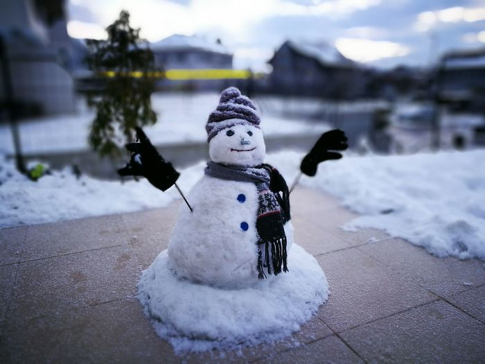 Snowman On Footpath During Winter