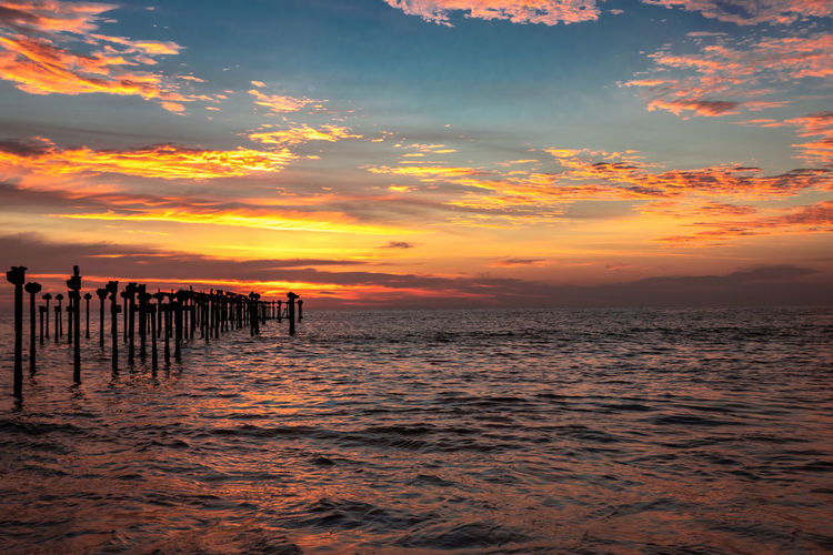 Orange cloud sunset view at alleppey beach India Allaphuza Beach Alleppey Background Beach Beach Clouds Beautiful Beauty Blue Cloud Clouds Cloudscape Coast Color Colorful Dramatic Dusk Evening Horizon Kerala Tourism Landscape Light Natural Nature Ocean Orange Red Reflection Scenery Sea Sky Summer Sun Sunlight Sunrise Sunset Travel View Water Weather White Yellow Iron Poles Orange Sky Orange Clouds Sea Orange Horizon Sea Horizon Sea Water Beach Evening Sea Beach