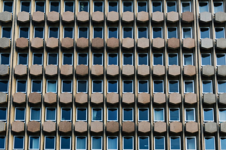 Full Frame Backgrounds Repetition No People Built Structure Pattern Building Exterior Architecture Day Side By Side Blue Design Geometric Shape Shape Outdoors In A Row Window Building Sunlight Order