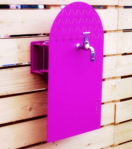 Water tap on purple board