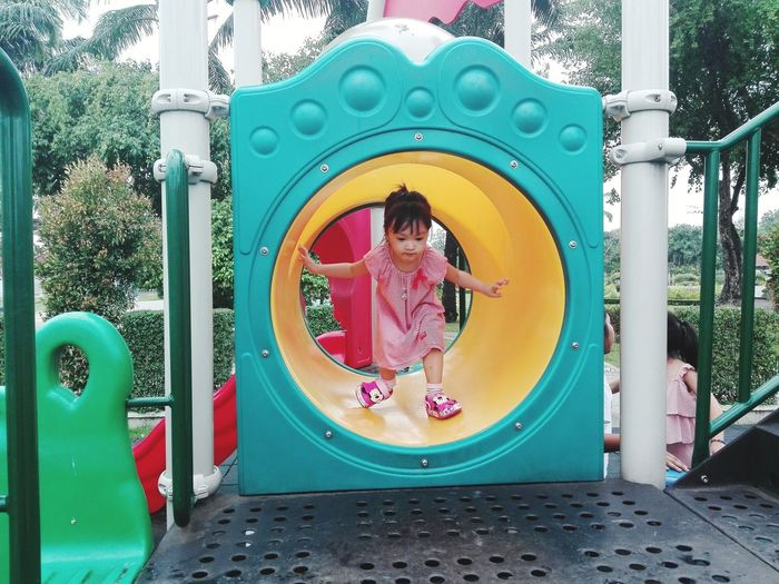 Low angle view of girl in playground