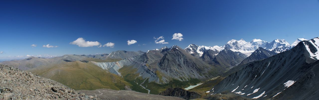 Panoramic View Of Altai Mountains Against Blue Sky