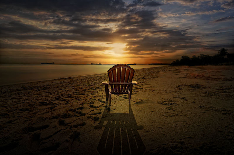 a chair at Kemala beach Sky Cloud - Sky Beach Sunset Land Sand Beauty In Nature Sea Orange Color Water Nature Scenics - Nature Tranquil Scene Tranquility Horizon Horizon Over Water No People Idyllic Outdoors Chair Sunrise