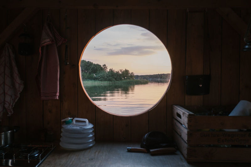 Scenic view of lake seen through boat during sunset