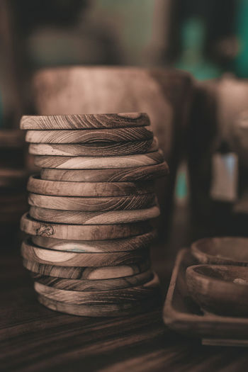 Stack of wooden plates on table