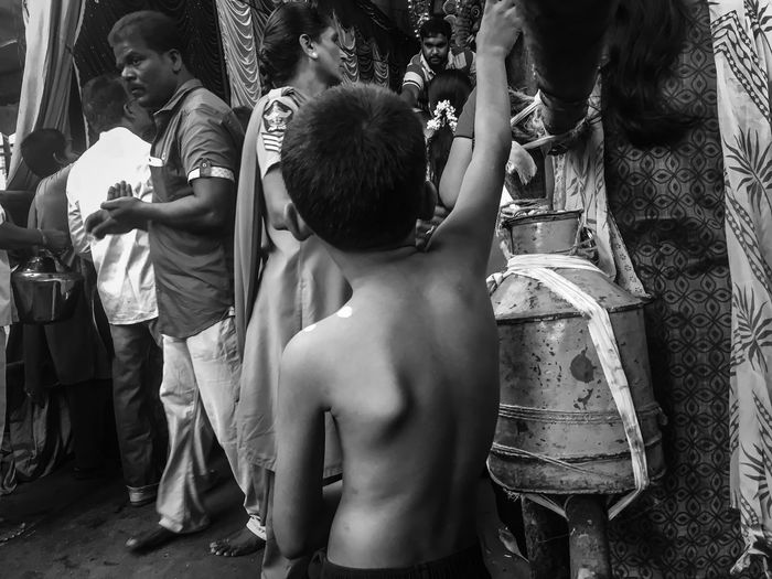 Child on a street Streetphotography Street Photography Monochrome Blackandwhite Black And White Black & White Weak Real People Lifestyles Childhood Boys Togetherness Leisure Activity Outdoors Day Men Casual Clothing Standing Playing Shirtless Women Friendship Adult People
