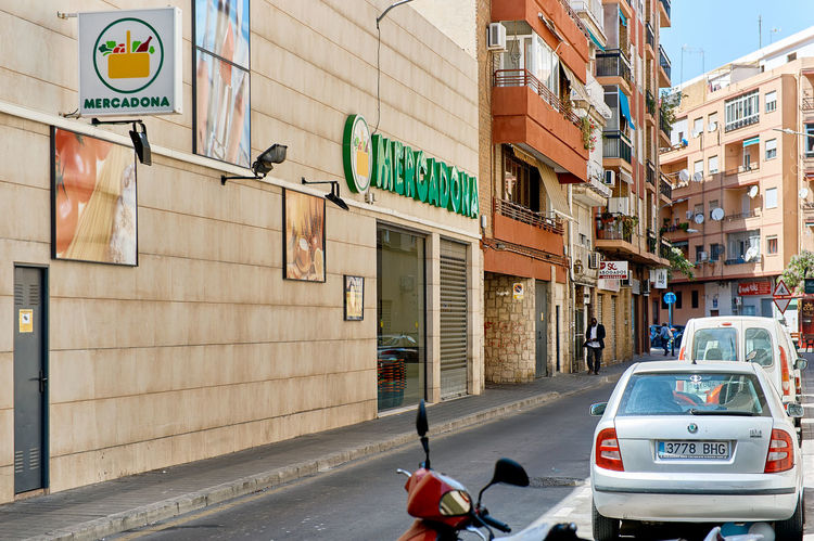 Alicante, Spain - May 17, 2017: Facade of Mercadona hypermarket. Mercadona is a Spanish family-owned supermarket chain with locations in 46 provinces, founded in 1977. Spain Alicante Province Spain Costa Blanca Façade Market Road SPAIN Sign Summertime Supermarket Advertisement Architecture Building Exterior Built Structure City Day Editorial  Hypermarket Mercadona Outdoors Signboard Store Street Sunny Day Superstore Urban Landscape