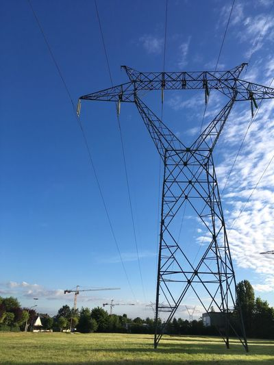 Cable Day Sky Electricity Pylon Electricity  Fuel And Power Generation Connection Power Line  No People Power Supply Outdoors Field Blue Low Angle View Cloud - Sky Tree Technology Landscape Nature Grass