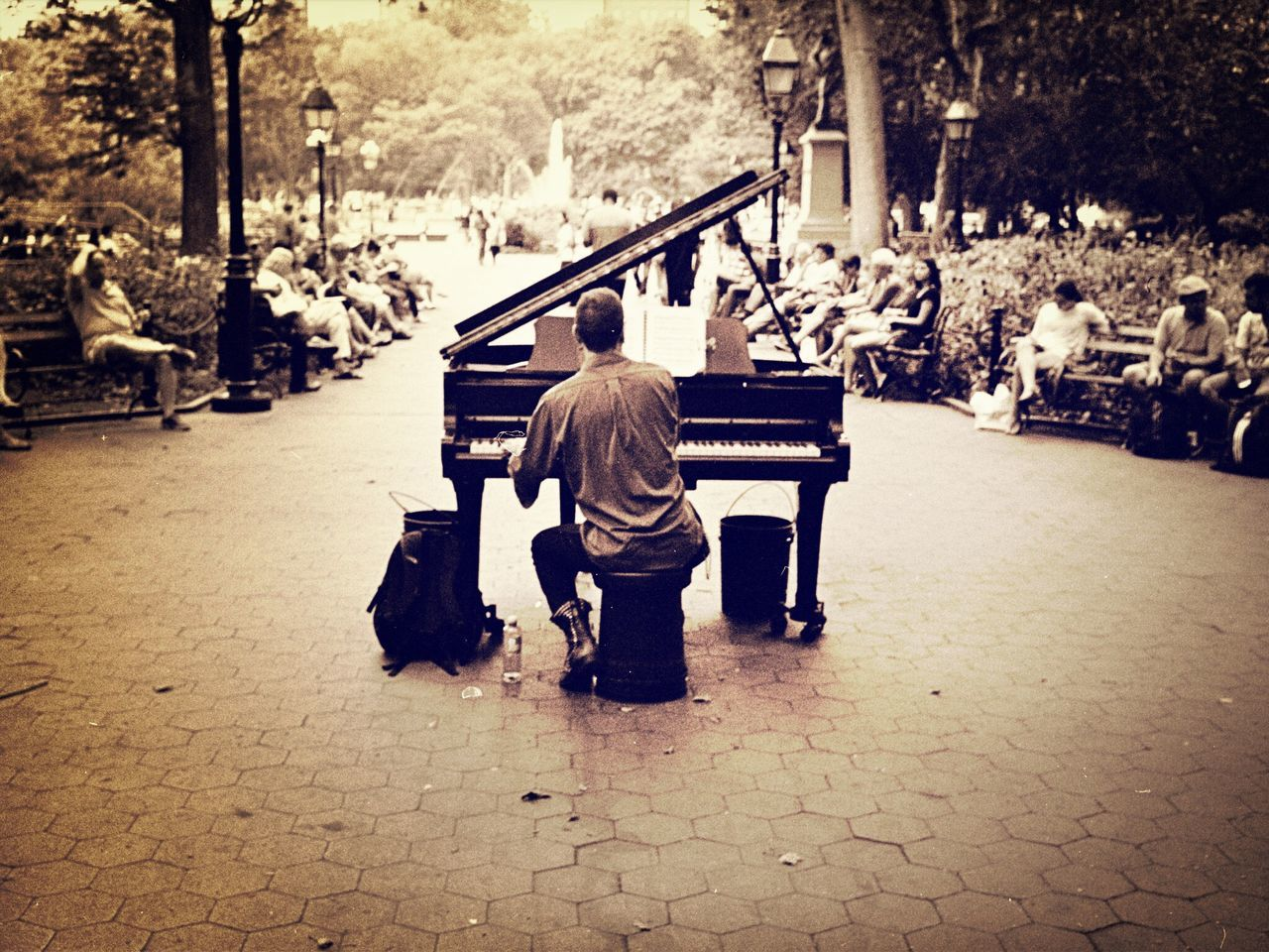 real people, musical instrument, music, men, lifestyles, musician, playing, large group of people, day, sitting, full length, outdoors, adult, people
