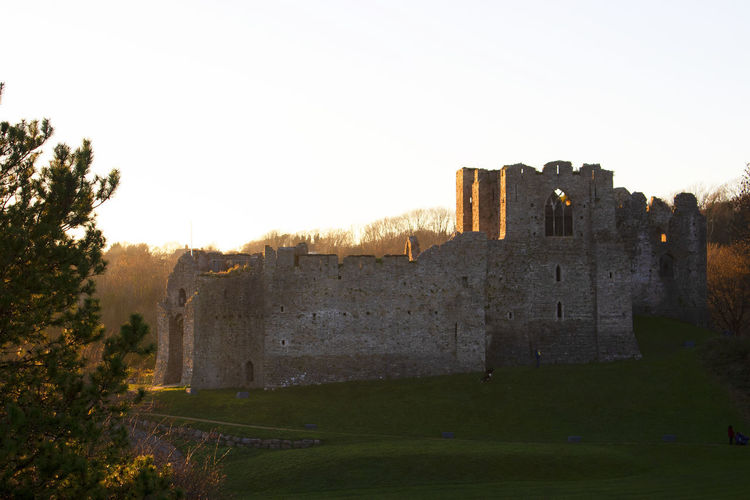 Sun begins to set at Oystermouth Castle, Mumbles Swansea Architecture Built Structure Sky Building Exterior History The Past Tree Fort Old No People Ancient Building Day Outdoors Castle Oystermouth Castle