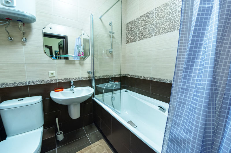 Bathroom Domestic Bathroom Sink Flooring Indoors  Hygiene Tile Toilet Home Household Equipment Domestic Room Mirror Faucet No People Bathroom Sink Tiled Floor Absence Modern Home Interior White Color Luxury Clean