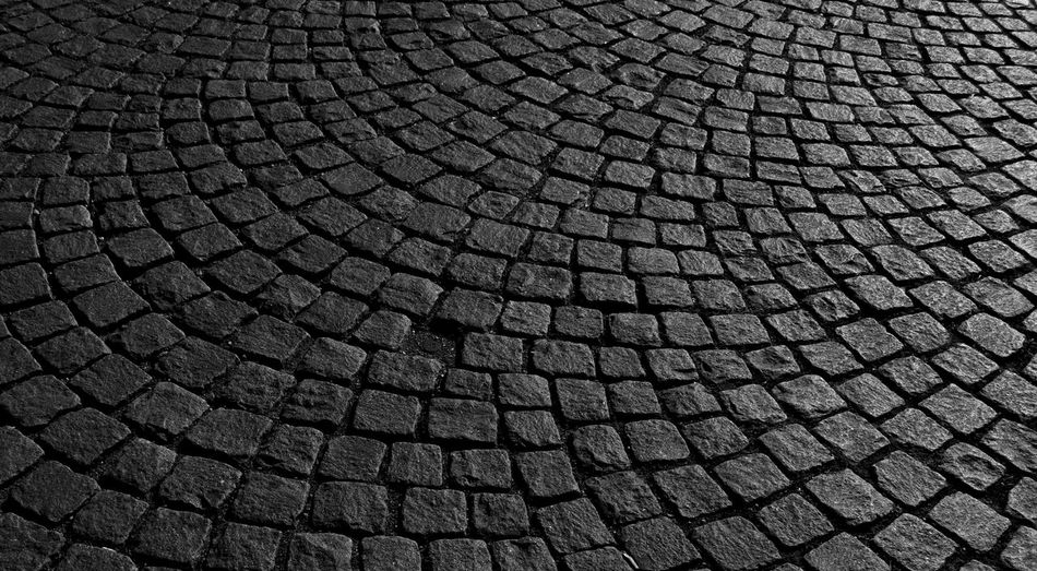 Backgrounds Pattern Full Frame Textured  Cobblestone No People Close-up Shape Street Repetition Geometric Shape Design Outdoors High Angle View City Day Circle Gray Black Color Stone Concentric It's About The Journey