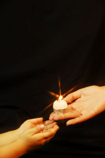 Help Adult Black Background Burning Candle Close-up Flame Heat - Temperature Holding Human Body Part Human Hand Illuminated Indoors  Night One Person People Real People Studio Shot Transfer Transfer Print Transfert Pass Love Love Give Give Up