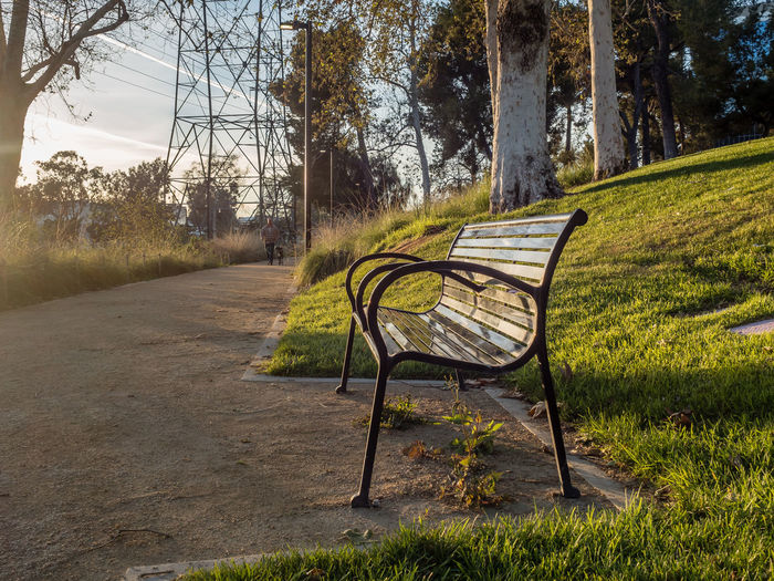 Empty bench in the evening sun Bench City Life Empty Evening Sun No People Park Rest Retirement Shadow Tranquility Vacant