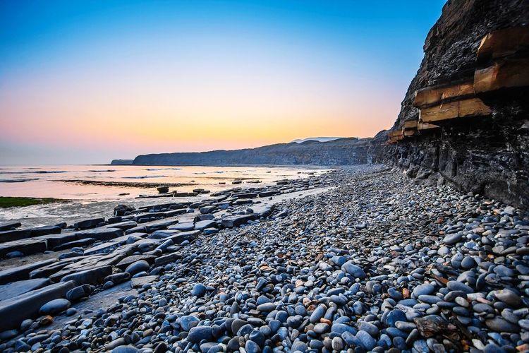Beach EyeEm Selects Pebble Beach Snow Sea Water Cold Temperature Sunset Frozen Water Beach Winter Blue
