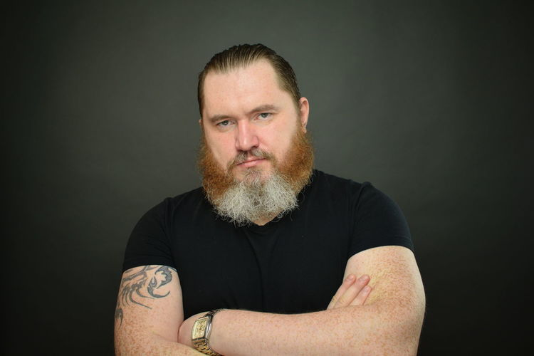 Portrait of mid adult man over black background