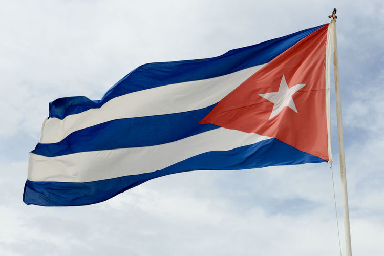 Bay Of Pigs Cuba Blue Cloud - Sky Day Flag Girón Low Angle View No People Outdoors Patriotism Red Sky Waving Wind