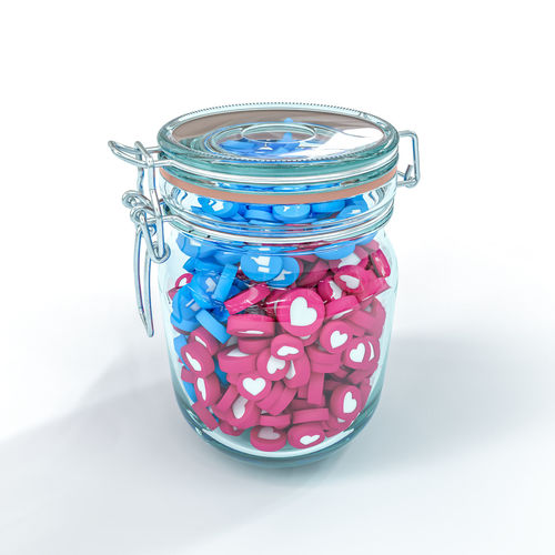 Close-up of glass jar on table against white background