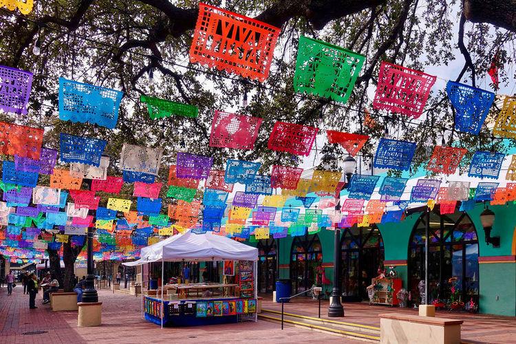Multi colored umbrellas in city