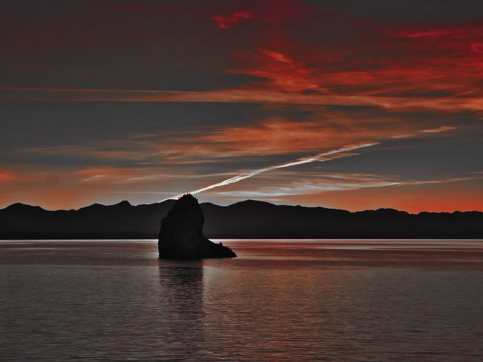 Fifeshire Rock Water Sky Beauty In Nature Sunset Scenics - Nature Waterfront Cloud - Sky Tranquil Scene Tranquility Silhouette Nature Idyllic Mountain Orange Color Sea Reflection Non-urban Scene Outdoors NZ South Island Fifeshire Rock Nelson