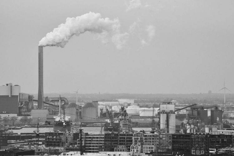 Smoked City How Do You See Climate Change? Climate Change Environmental Issues Environment Eye4photography  EyeEm Gallery How Do We Build The World? City Industrial Landscapes Industrial Pollution In My World Blackandwhite Sky And Clouds Factory Industry Smoke Stack Fumes Smog Smoke - Physical Structure Environment Chimney Steam Power Station Emitting Air Pollution Atmospheric Pollution Environmental Damage Smoke Vapor Trail