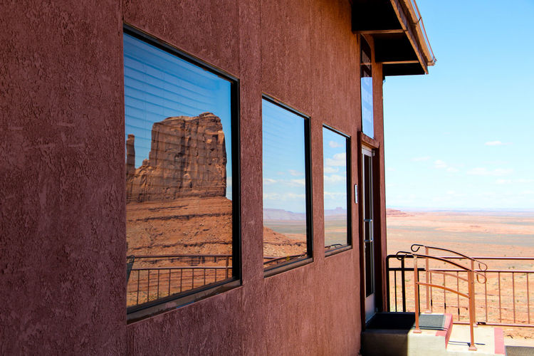 Architecture Built Structure Window Building Exterior Sky No People Day Building Nature Low Angle View Outdoors Glass - Material Sunlight House Railing Wood - Material Residential District Brown Clear Sky Wall - Building Feature Monument Valley