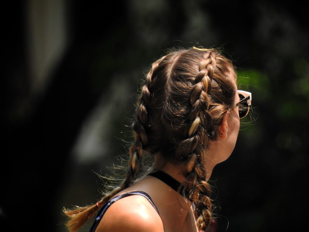 real people, rear view, one person, focus on foreground, headshot, hair bun, lifestyles, leisure activity, outdoors, day, women, young adult, young women, close-up, blond hair, people