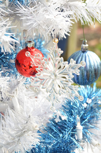 transparent snowflake ornaments on white Christmas tree Christmas Christmas Christmas Decoration Christmas Decorations Christmas Ornament Christmas Tree Christmastime Close-up Day No People Ornament Ornaments Tree Whie