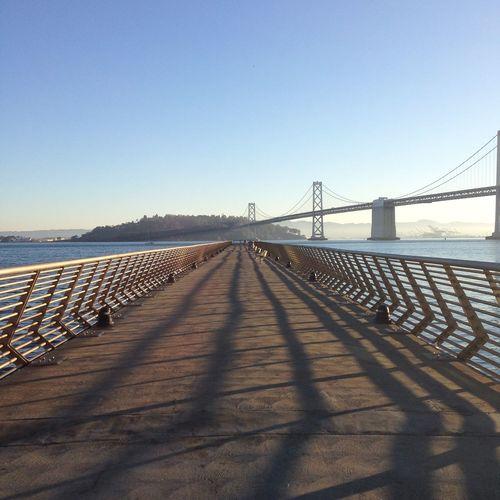 Bridge over river against clear sky