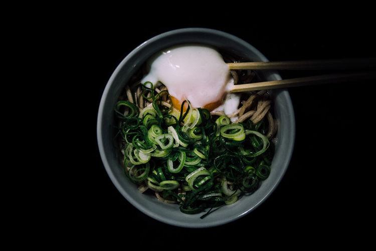 Close-Up Of Soba Noodles In Bowl On Black Background