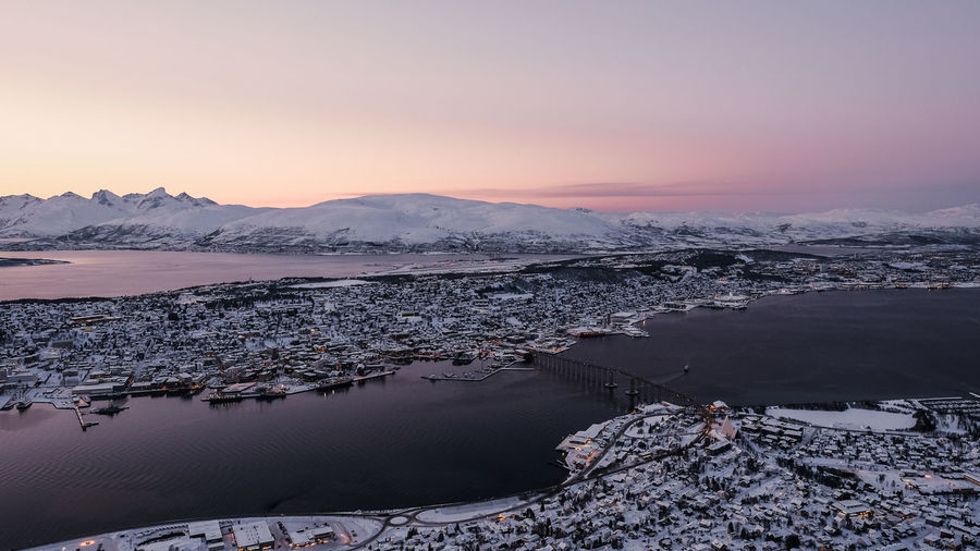 Sunset in Tromso Scenics - Nature Beauty In Nature Sky Sunset Tranquil Scene Water Tranquility Winter Nature Snow Cold Temperature Idyllic Mountain Snowcapped Mountain Landscape Outdoors Non-urban Scene Tromsø Fjellheisen Norway Fjord View Pink Sky Pink Skies No People