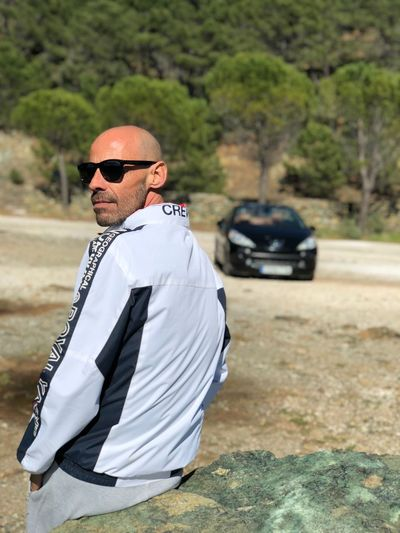 207 Peugeot EyeEm Selects Real People Sunglasses One Person Glasses Fashion Day Standing Focus On Foreground Lifestyles Outdoors Nature Leisure Activity Transportation Clothing Men Portrait Sunlight Full Length Young Adult