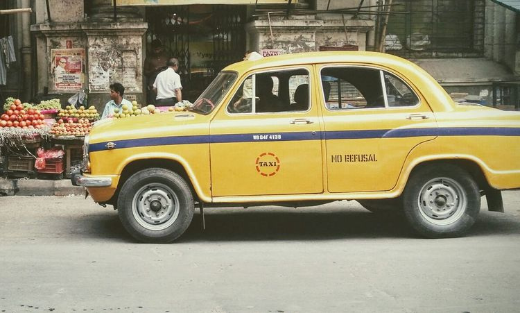 Nostalgia thy name is Kolkata Kolkata Car Transportation Mode Of Transport Land Vehicle Street Taxi Outdoors Old-fashioned Yellow Taxi Kolkata Taxi Kolkatadiaries Kolkatacity KolkataStreets Kolkatamemories Kolkatadiary Connected By Travel