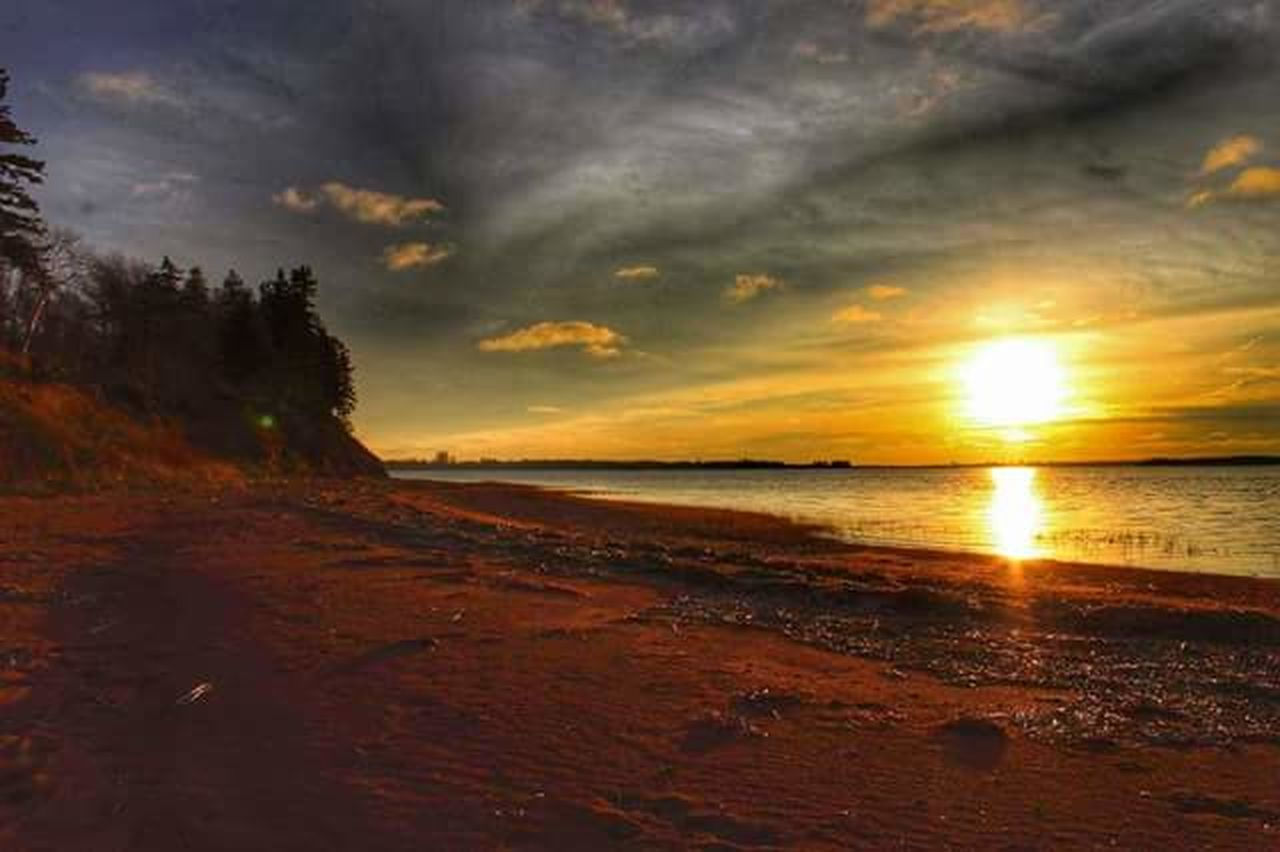 sunset, sea, scenics, nature, sun, cloud - sky, beach, horizon over water, beauty in nature, water, tranquil scene, sky, reflection, outdoors, tranquility, sand, no people, travel destinations, landscape, day