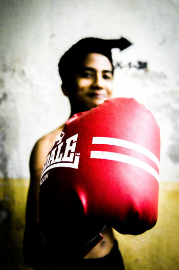 BUMAYE..! Mid Adult Men Mid Adult EyeEm Selects One Young Man Only EyeEmNewHere EyeEmSelect People Day Human Body Part Close-up Boxing - Sport One Person Men Boxing Glove Adult Protection Indoors  Red Only Men One Man Only EyeEm Best Shots Macho Sports Uniform Dedication Athlete The Week On EyeEm