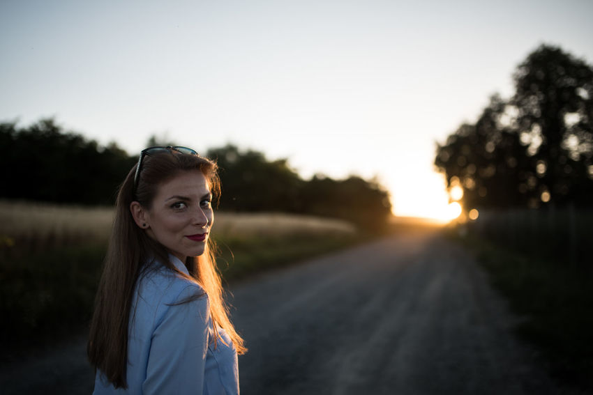 Beautiful Woman Beauty In Nature Country Dust Dusty Road Golden Hour Lifestyle Lifestyles Nature Posing Posing For The Camera Rays Rays Of Light Rear View Road Summer Summer Vibes Sunset Woman Portrait Fashion Stories