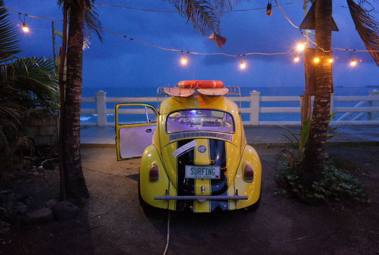 Beach Beetle Classic Land Vehicle Mode Of Transport Night Outdoors Street Light Surf Car Surface Level Surfing Transportation Vintage Car Yellow Car
