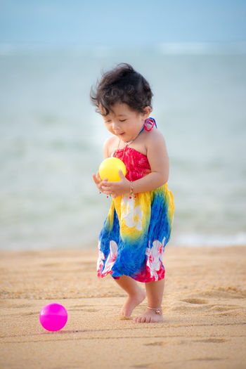Cute girl with toy on beach