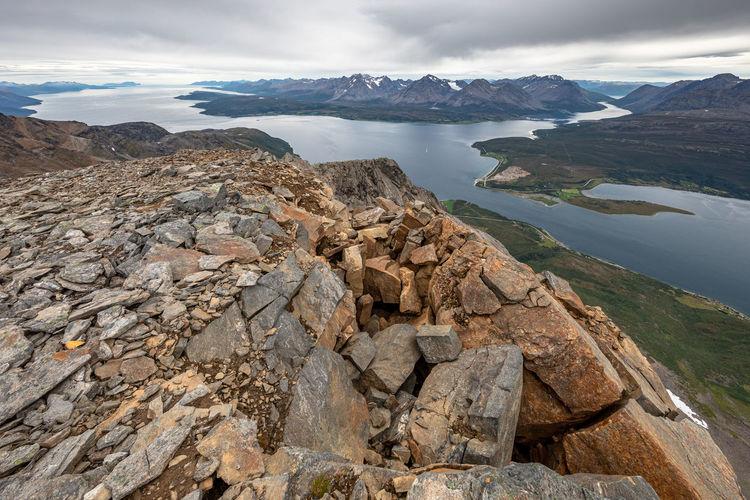 Scenic view of rocks in lake against sky