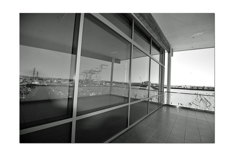 Ferry Landing Building 6 Observation Deck Jack London Square Port Of Oakland Ca Waterfront Retail And Office Building 32,000 Sq. Ft. Designed From The Maritime Vernacular Adjacent To The Port Building Overlooks Ferry Landing & Dock Oakland To San Francisco Ferry Industry Meets Retail Working Port Entertainment District Port Cranes Overlooks The Ferry Landing & Dock Embarcadero Cove Window Reflections Reflection Reflection_collection Reflected Glory Reflection Photography Black & White Black And White Black And White Collection  Monochrome Black And White Photography