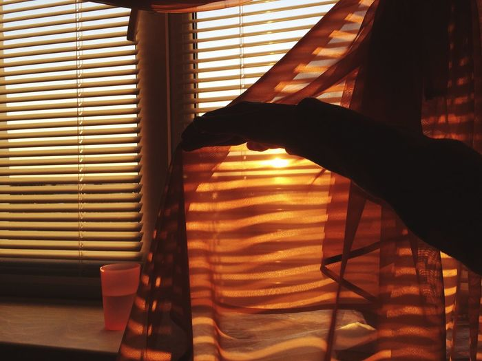 Sunrise New Day Hello Morning! Real People Indoors  One Person Human Body Part Sunlight Human Hand Hand Window Lifestyles Unrecognizable Person Close-up Blinds Creative Space