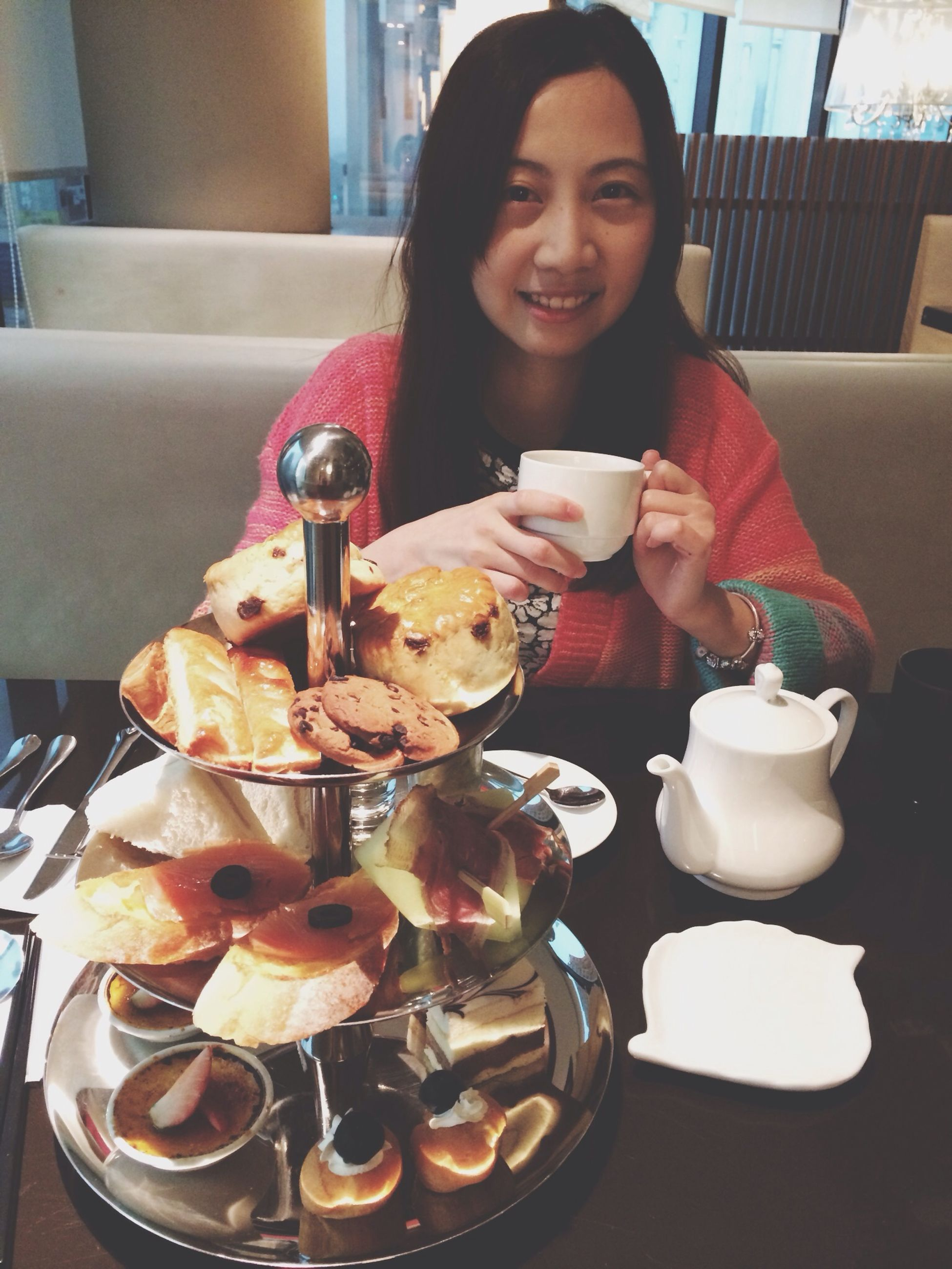 food and drink, indoors, food, freshness, table, ready-to-eat, sweet food, plate, indulgence, lifestyles, dessert, unhealthy eating, sitting, restaurant, leisure activity, drink, person, holding
