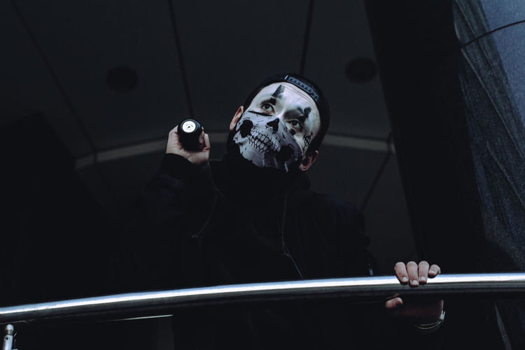 Low angle view of man with spooky make-up