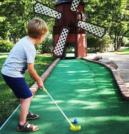 Child playing minigolf at the windmill Color Color Photography EyeEm Best Shots Eye4photography  Minigolf Minigolfcourse Mini Golf Mini Golfing Mini Golfing ⛳ Child Kid Kids Being Kids Having Fun Kids Boy Playing Windmill Windmills People Photography People Kids Having Fun Kids Playing Children Children Photography Children's Portraits