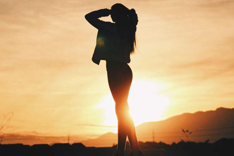 Sunset Silhouette Real People Women Sky Lifestyles One Person Leisure Activity Nature Sun Outdoors Beauty